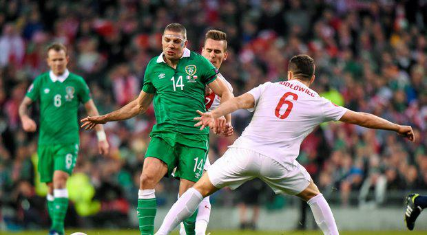 Jon Walters, Republic of Ireland, in action against Tomasz Jodlowiec, Poland. UEFA EURO 2016 Championship Qualifier, Group D, Republic of Ireland v Poland. Aviva Stadium, Lansdowne Road, Dublin. Picture credit: Pat Murphy / SPORTSFILE