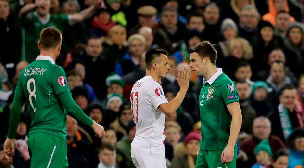 Republic of Ireland's Seamus Coleman (right) and Poland's Slawomir Peszko confront each other during the UEFA Euro 2016 Qualifier at the Aviva Stadium, Dublin