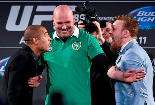 31 March 2015; UFC featherweight Champion Jose Aldo, left, faces off against UFC featherweight title challenger Conor McGregor as UFC President Dana White tries to separate them during a UFC fan event. The Convention Centre Dublin, Spencer Dock, North Wall Quay, Dublin. Picture credit: Ramsey Cardy / SPORTSFILE