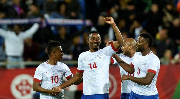 Cape Verde's defender Gege (2L) celebrates after scoring against Portugal during the EURO 2016 friendly football match Portugal vs Cape Verde at the Antonio Coimbra da Mota stadium in Estoril