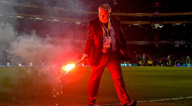 A flare is removed from the pitch before Ireland's UEFA EURO 2016 Championship Qualifier with Poland