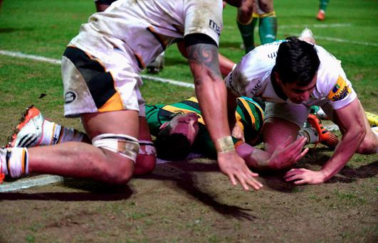 George North of Northampton Saints lays injured after colliding with Nathan Hughes of Wasps as he scored his second try during the Aviva Premiership match between Northampton Saints and Wasps at Franklin's Gardens on March 27