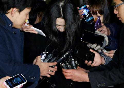 Cho Hyun-ah (C), also known as Heather Cho, daughter of chairman of Korean Air Lines, Cho Yang-ho, is surrounded by media as she leaves for a detention facility after a court ordered her to be detained, at the Seoul Western District Prosecutor's office in this December 30, 2014 file photo. Cho, the former Korean Air Lines executive jailed for her outburst over in-flight service, known as the