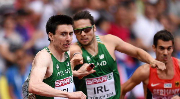 Ireland's Mark English takes the baton from Brian Gregan during their 4x400m men's relay final where they finished 5th in a new national record time of 3:01.67