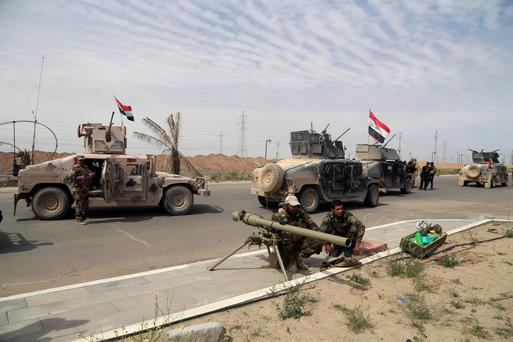Iraqi security forces deploy in Tikrit, 80 miles (130 kilometers) north of Baghdad, Iraq (AP Photo/Khalid Mohammed)