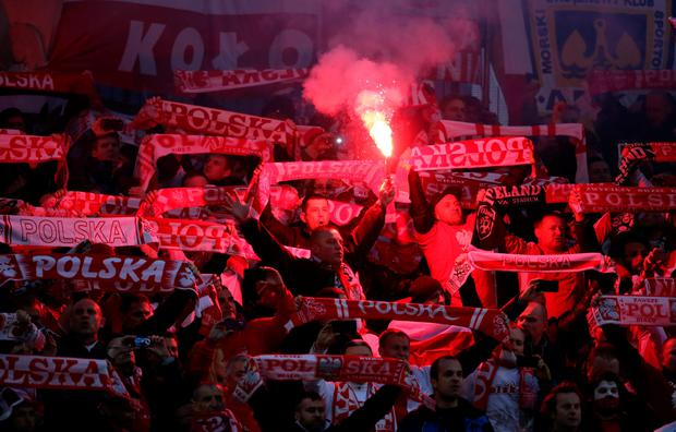 Poland fans let off a flare during the UEFA Euro 2016 Qualifier at the Aviva Stadium, Dublin, Ireland