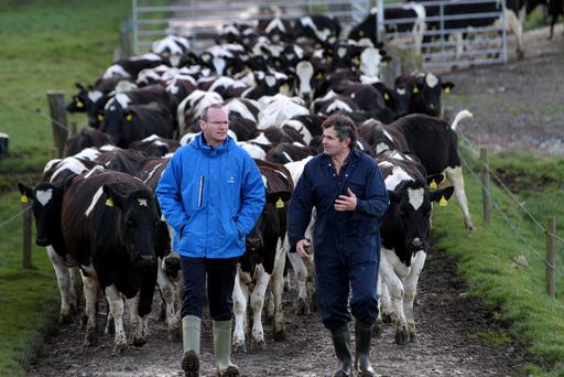 Agriculture Minister Simon Coveney with dairy farmer Bobby Hovenden from Co Laois. Bobby is a certified member of Bord Bia's Sustainable Dairy Assurance Scheme, the world's first national sustainability and quality assurance scheme for dairy farming