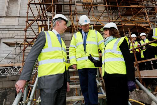 Tanaiste Joan Burton, Construction Industry Federation director Tom Parlon and CIF President Michael Stone (left) launch a campaign at the National Gallery to help unemployed construction workers