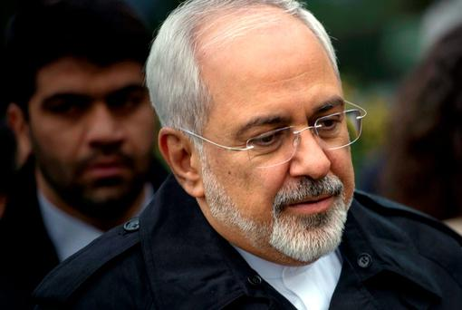 Iranian Foreign Minister Javad Zarif is seen as he walks through a courtyard at the Beau Rivage Palace Hotel during an extended round of nuclear talks in Lausanne. Photo: Reuters
