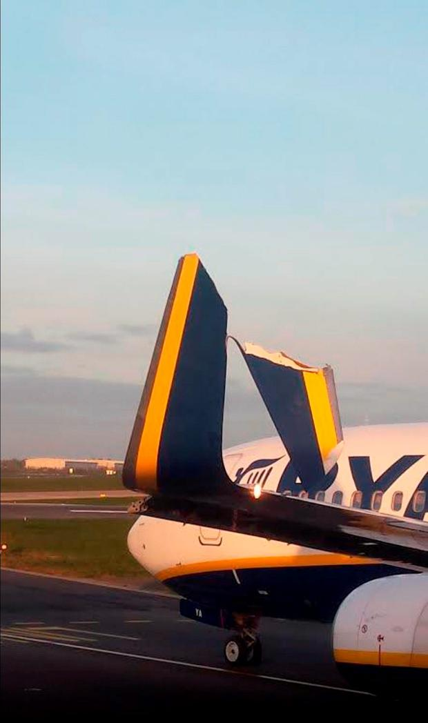 Photo courtesy of Paul Roche of one of the Ryanair planes at Dublin Airport with a damaged wing after hitting another Ryanair plane. Photo: PA