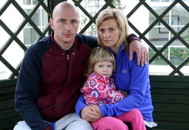 Marcin, Alicia (2) and Jolanta Podmokli (pictured in the Keadeen Hotel) who were a residents of one of the houses in Millford Manor, which burned down in Newbridge, Co. Kildare
