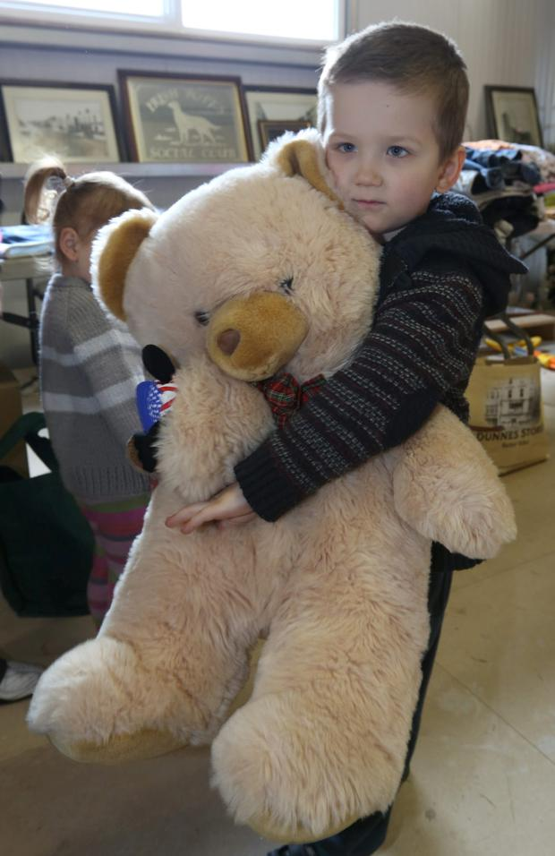 Little Maksim Kuzovkin (4) donated his Teddy Bear at The Millfield Fire Relief centre at The Ryston Sports and Social Club, Newbridge