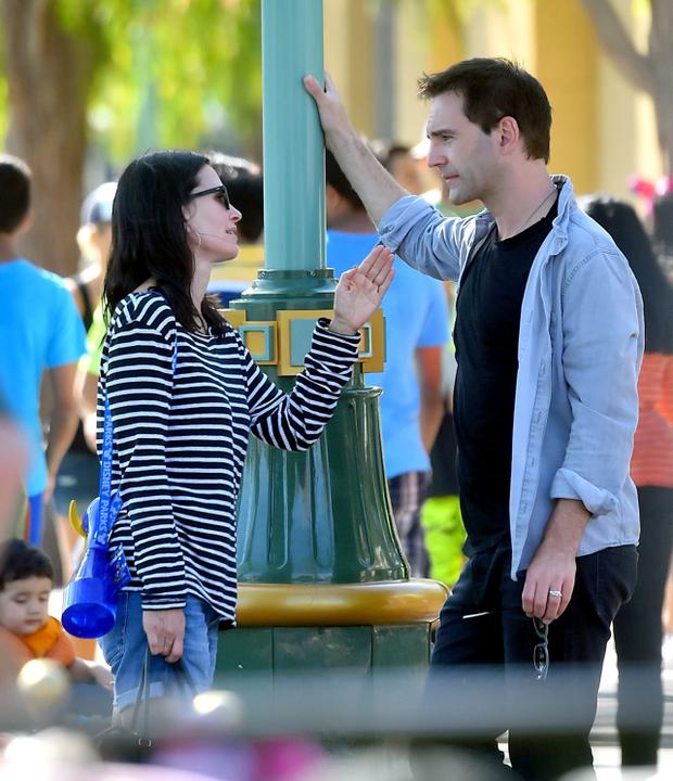 EXCLUSIVE: Courteney Cox and her fiance Johnny McDaid spend a day at Disneyland with Courteney's daughter Coco. Johnny McDaid was seen wearing a ring on his wedding ring finger. are they married already?