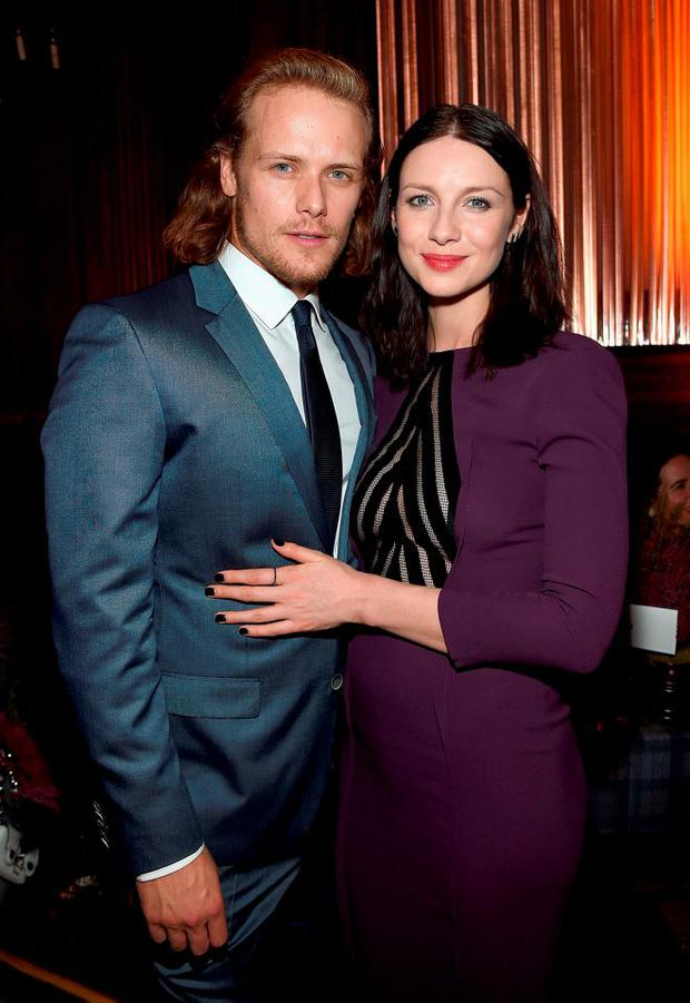 Sam Heughan and Caitriona Balfe attend the