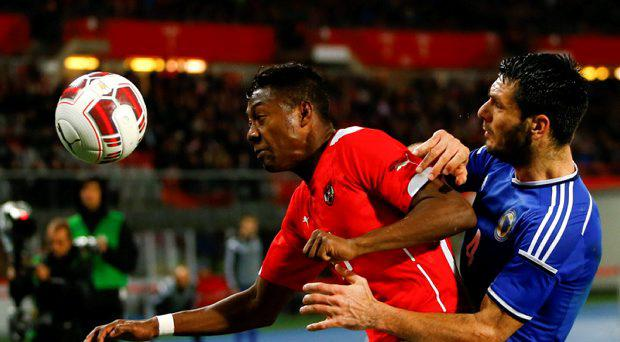 Austria's David Alaba (L) challenges Bosnia and Herzegovina's Emir Spahic during their international friendly