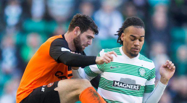 Dundee United's Nadir Ciftci (left) and Celtic's Jason Denayer (right)