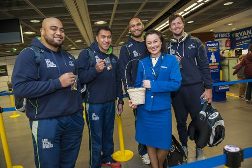 Caption: Connacht Rugby players Rodney Ah You, Mils Muliaina, George Naoupu and Danie Poolman, with Ryanair cabin crew member Adriana Siemieniuk at Dublin Airport, as Ryanair kicked off its Dublin summer 2015 schedule. Pic: Fintan Clarke