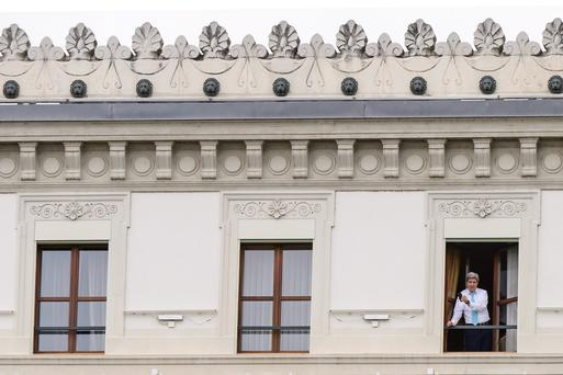 U.S. Secretary of State John Kerry, uses his mobile phone while standing at a window of the hotel as the Iran nuclear talks continue, in Lausanne, Switzerland. (AP Photo/Keystone,Jean-Christophe Bott)