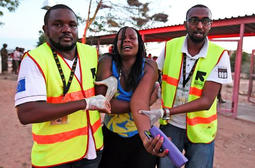 Paramedics help a student who was injured during an attack by Somalia's Al-Qaeda-linked Shebab gunmen on the Moi University campus in Garissa. Photo: AFP PHOTO/Getty Images