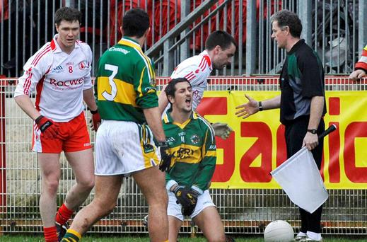 Ryan McMenamin, Tyrone, is involved in an incident with Paul Galvin, Kerry