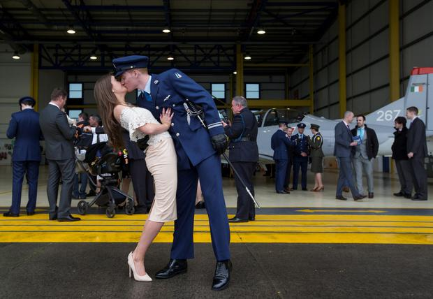 Emma Day gives her partner Lt Kevin Fitzgerald a kiss after he was one of five Cadets to be awarded with their Military Pilots Wings and Presidential Commissions at a Ceremony in the Air Corps Headquarters in Casement Aerodrome, Baldonnel. Pic:Mark Condren 2.4.2015