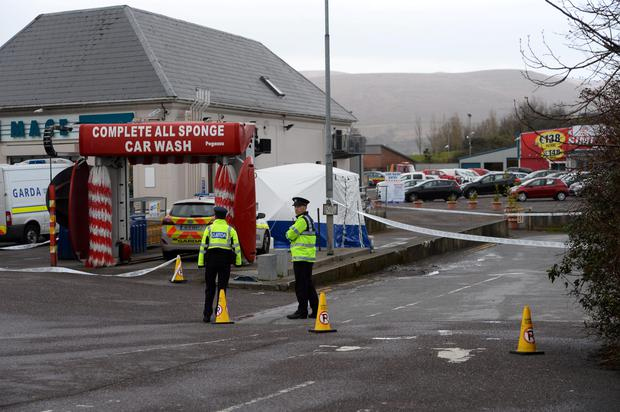 Gardai have confirmed the discovery of a body in Tralee. The scene at Kellihers Garage, Rathass Tralee has been preserved