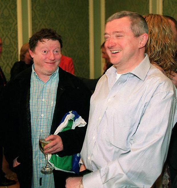 GEORGE BYRNE AND LOUIS WALSH AT THE LAUNCH OF LOUIS WALSH'S HISTORY OF IRISH POP AT THE FOUR SEASONS HOTEL PIC RAY CULLEN 27/3/2002