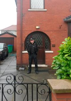 Police outside the home of Labour councillor Shakil Ahmed whose son is one of nine Britons detained in Turkey on suspicion of trying to cross the border into Syria. Photo: Pat Hurst/PA Wire