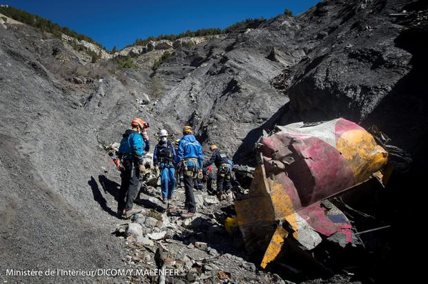 Rescue workers and investigators, seen in this picture made available to the media by the French Interior Ministry April 1, 2015, work near debris from wreckage at the crash site of a Germanwings Airbus A320, near Seyne-les-Alpes