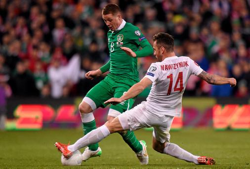 Ireland's James McCarthy in action against Jakub Wawrzyniak of Poland during their Euro 2016 qualifier at the Aviva. Photo: Pat Murphy / SPORTSFILE
