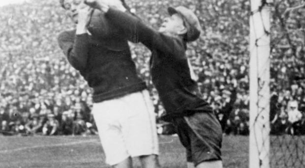 Kerry full-back Joe Barrett (left) comes to the aid of his goalkeeper Johnny Riordan as he catches a ball in the 1929 All-Ireland final against Kildare. A legendary figure in Kerry football history, Barrett showed great leadership on and off the field - something which today's players could learn from. Photo: terracetalk.com / TJ Flynn