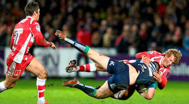 Robbie Henshaw, Connacht, is tackled by Billy Twelvetrees, Gloucester Rugby