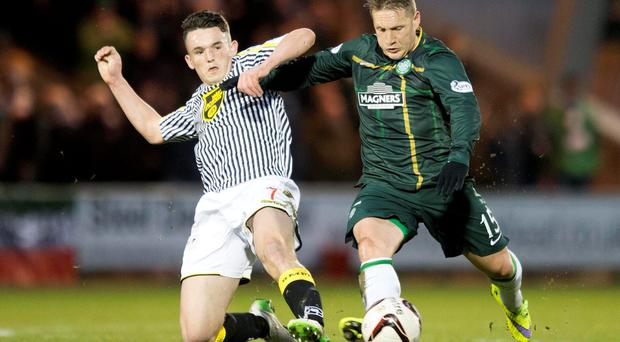 Celtic midfielder Kris Commons gets past a challenge from St Mirren's John McGinn during their Scottish Premiership clash at St Mirren Park. Photo: Jeff Holmes/PA Wire