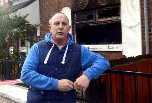 Paul Savage, who helped in the rescue, at the scene in the Ardoyne, north Belfast