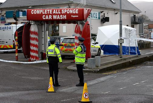 Gardai at the scene where the man's body was found in Tralee