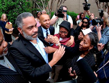 Anthony Ray Hinton is greeted by family outside the Jefferson County Jail in Birmingham, Alabama REUTERS/Marvin Gentry