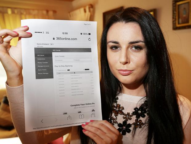 Meg McMenamin with her bank statement at her Knocklyon home yesterday PIC COLIN O'RIORDAN