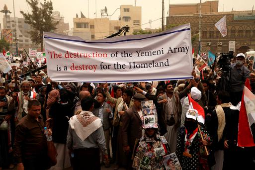 Supporters of Yemen's former President Ali Abdullah Saleh participate during a rally against air strikes in Sanaa REUTERS/Mohamed al-Sayaghi
