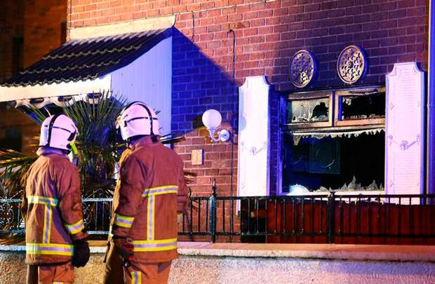 Police and firefighters at the scene of a major house fire in the Ardoyne area of North Belfast on Thursday night. 3 occupants including an infant believed to be aged14 weeks. Picture: Kevin Scott