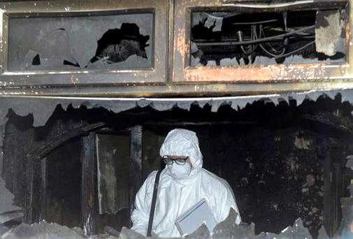 Forensic investigators yesterday at the scene of the house blaze In Jamaica Street in Ardoyne, Belfast