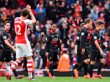 Liverpool's English midfielder Raheem Sterling (C) reacts as he leaves the pitch after the English Premier League football match between Arsenal and Liverpool at the Emirates Stadium in London on April 4, 2015. Arsenal won the game 4-1. AFP PHOTO / BEN STANSALL RESTRICTED TO EDITORIAL USE. NO USE WITH UNAUTHORIZED AUDIO, VIDEO, DATA, FIXTURE LISTS, CLUB/LEAGUE LOGOS OR LIVE SERVICES. ONLINE IN-MATCH USE LIMITED TO 45 IMAGES, NO VIDEO EMULATION. NO USE IN BETTING, GAMES OR SINGLE CLUB/LEAGUE/PLAYER PUBLICATIONS.BEN STANSALL/AFP/Getty Images