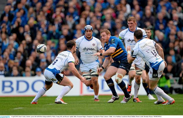 Sean Cronin, Leinster, passes the ball before being tackled by Micky Young, left, and Horacio Agulla, Bath