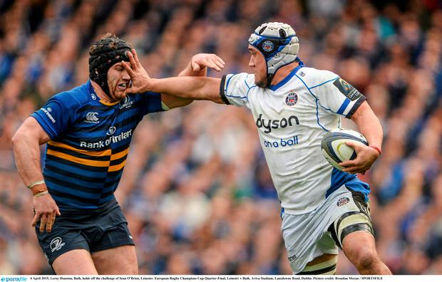 Leroy Houston, Bath, holds off the challenge of Sean O'Brien, Leinster. European Rugby Champions Cup Quarter-Final