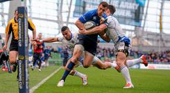 Zane Kirchner, Leinster, is pushed out of play by Micky Young, Bath, just short of the tryline