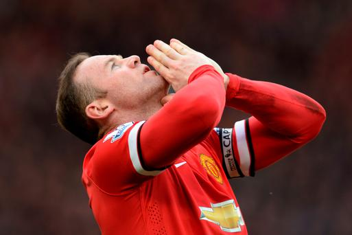 Manchester United's English striker Wayne Rooney celebrates scoring their second goal during the English Premier League football match between Manchester United and Aston Villa at Old Trafford