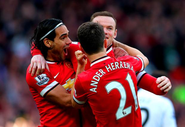 MANCHESTER, ENGLAND - APRIL 04: Wayne Rooney of Manchester United celebrates with team-mates after scoring his team's second goal during the Barclays Premier League match between Manchester United and Aston Villa at Old Trafford on April 4, 2015 in Manchester, England. (Photo by Alex Livesey/Getty Images)