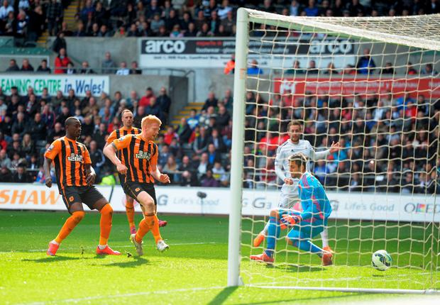 Paul McShane of Hull City scores past Lukasz Fabianski