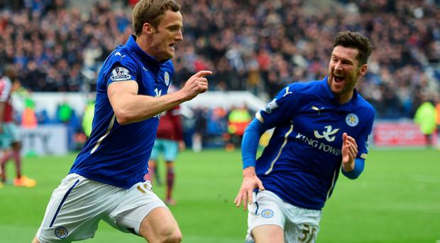 Andy King of Leicester City (L) celebrates scoring their second goal with David Nugent