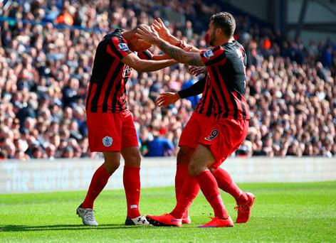 Bobby Zamora of QPR (L) celebrates scoring their third goal with Charlie Austin of QPR during the Barclays Premier league match West Bromwich Albion and Queens Park Rangers at The Hawthorns on April 4, 2015 in West Bromwich, England. (Photo by Matthew Lewis/Getty Images)