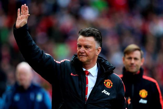 Louis van Gaal, manager of Manchester United waves to the fans as he walks out for the Barclays Premier League match between Manchester United and Aston Villa at Old Trafford on April 4, 2015 in Manchester, England. (Photo by Jan Kruger/Getty Images)